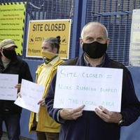 Residents stage protest outside west Belfast refuse centre which has not reopened since lockdown