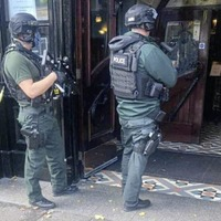 Drama as armed police enter Belfast city centre hotel during hunt for assault suspect