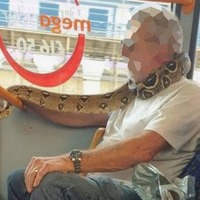 Man 'uses snake as a face mask' on bus