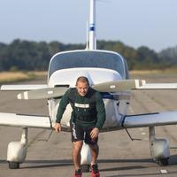 Kickboxer attempts marathon pulling a plane