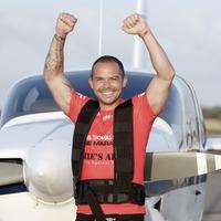 Kickboxer completes marathon pulling a plane