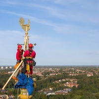 Father and son return weather vane to cathedral's towering spire