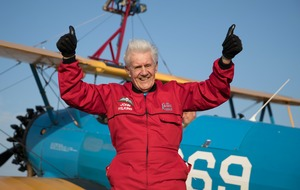 Octogenarian takes to the skies for charity wing walk