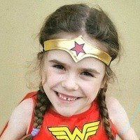 Disabled girl completes walking challenge dressed as Wonder Woman