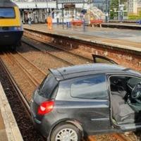 Car on train line causes rail diversion