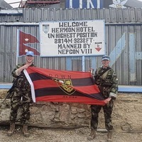Irish Army soldiers Tiarnan Burns and Cathal Matthews cheering on Down from base in Syria