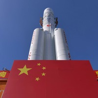 China positions rocket ahead of ambitious lunar mission