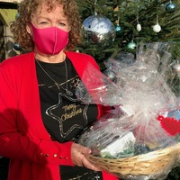 Lottery winners team up to deliver Christmas hampers to carers
