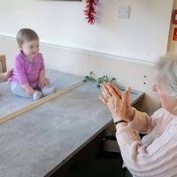 Care home resident meets great-grandchild for first time in Covid-secure reunion