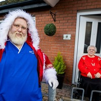 Santa lookalike care worker delivers festive cheer on home visits