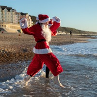 In Pictures: Care home visits, sledging and chilly swims mark Christmas Day