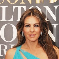 Liz Hurley and son dress up for New Year celebrations