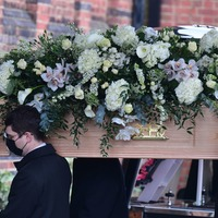 Dame Barbara Windsor laid to rest with flowers spelling out 'Babs' and 'Saucy'