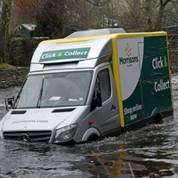 Brave fire crew save delivery driver from swollen river