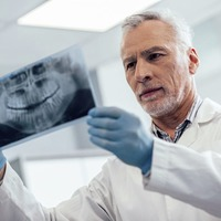 Ask the Dentist: Is it possible to regrow the bone around a loose tooth?