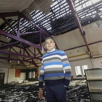 Multicultural centre volunteers boosted by public support after race hate arson as hopes for justice and new building fade