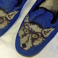Michael Collins' 'wolf' slippers cause social media stir