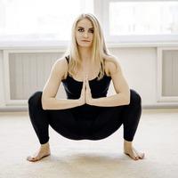 Home gym: Doing a 'yogi squat' to stretch glutes, hip flexors and lower back