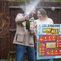 Furloughed bartender celebrates £100,000 scratchcard win after 'tough year'
