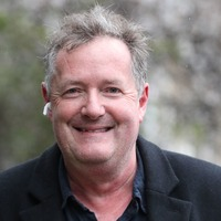 Piers Morgan marks 56th birthday by plunging his face into a cake