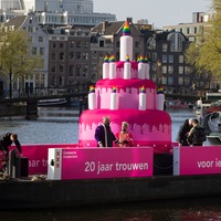 Inflatable pink cake sails down canals as Amsterdam celebrates same-sex weddings