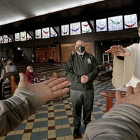 Blessing of the hands replaces `washing of the feet' on Holy Thursday in west Belfast