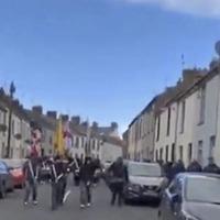 Loyalist 'band parade' involving masked men condemned