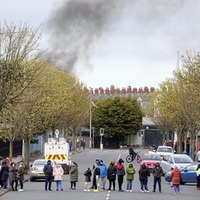 Serious disorder at a Belfast interface with a Translink bus petrol bombed and a press photographer assaulted