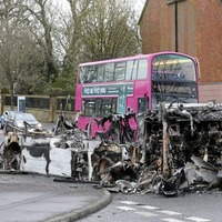 Rioters stopped Metro bus and ordered driver and passengers to get out before torching it as bus services suspended in wake of attack