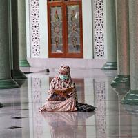 Muslims begin marking Ramadan with socially distanced prayers