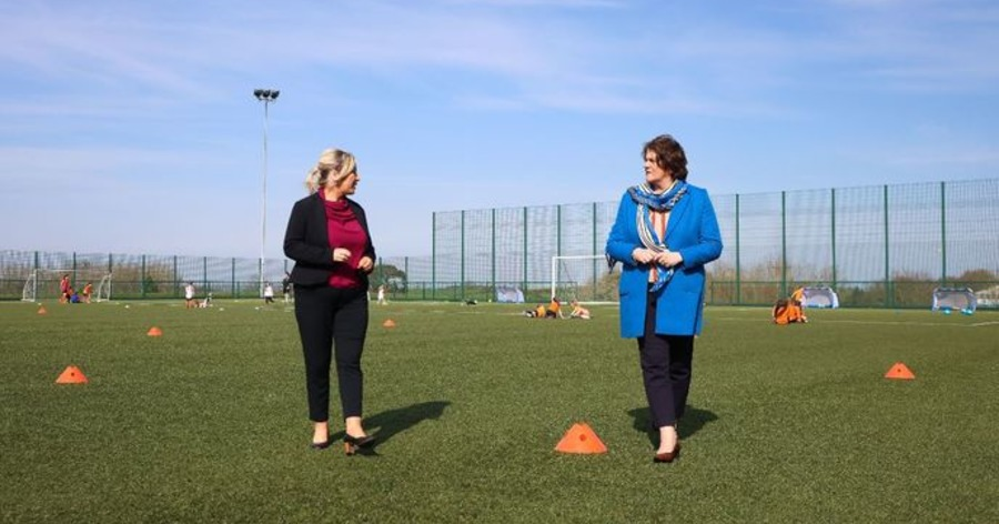 It all kicked off between Arlene Foster and Michelle O'Neill on a visit to see young footballers