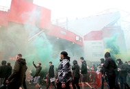 Manchester United v Liverpool postponed as violence mars anti-Glazer demonstration. Meanwhile, Man City march on