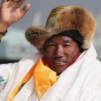 Sherpa guide scales Mount Everest for record 25th time