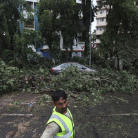 India scours sea after barge sinks and second vessel adrift following cyclone