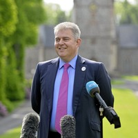 Northern Ireland Secretary's comments over Edwin Poots 'not helpful'