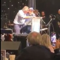 Van Morrison joined on stage by Ian Paisley for chant against Health Minister Robin Swann