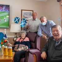 Roughie visits care home residents ahead of England clash