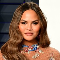 Chrissy Teigen threatens legal action against fashion designer in bullying row