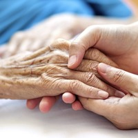 Older people's commissioner urges unvaccinated care home staff to get Covid jab