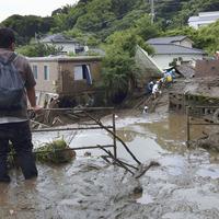 Dozens feared missing after Japanese resort town mudslide