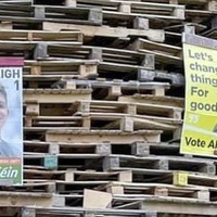 Posters belonging to justice minister Naomi Long and Sinn Féin election candidate placed on a bonfire