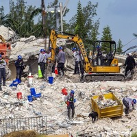 Tropical storm in Florida threatens renewed search at site of collapsed high-rise