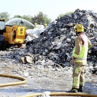 Police hunt arsonists after `deliberate ignition' of paper factory at north Belfast interface