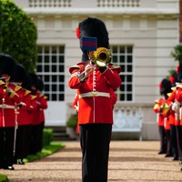 Three Lions and Sweet Caroline played at Clarence House at Charles's request