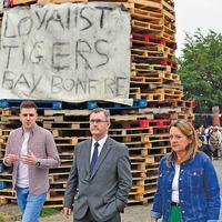 Jeffrey Donaldson visits north Belfast interface bonfire as Nichola Mallon and Jamie Bryson hold talks