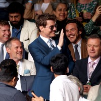Tom Cruise waves to fans as he makes Wimbledon return