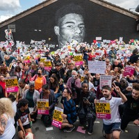 Hundreds of people take the knee beside recently-repaired Rashford mural