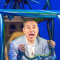 David Walliams tests out model helicopter on visit to Billionaire Boy set