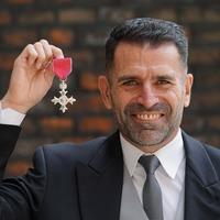 Former footballer Benali awarded MBE for raising £1.2m for cancer charity