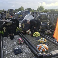 Wreaths laid at graved of Hooded Man Gerry McKerr to mark 50th anniversary of internment